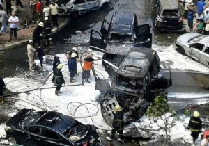 The prosecutor general's convoy after a bomb on a Cairo Street