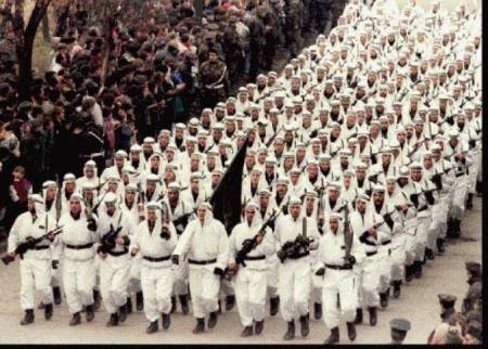 The Al-Quada-linked 'El-Mujahedeen' brigade of the Bosnian Muslim Army parading in downtown Zenica in central Bosnia in 1995, carrying the black flag of Islamic jihad
